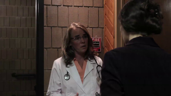 The Emergency Room Doctor (Gale Argentine) talks with Margaret Miller.