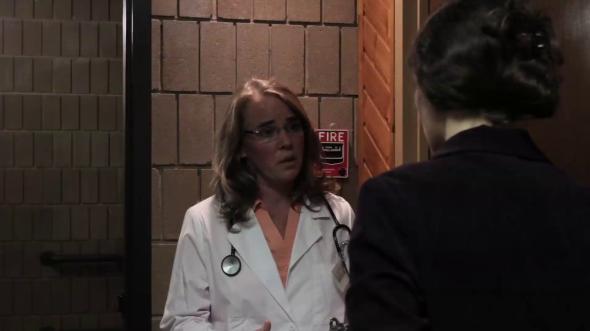 The Emergency Room Doctor (Gale Argentine) talks with Margaret Miller.