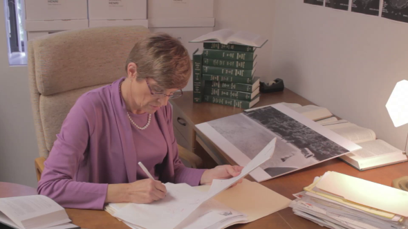 Constance Smith works in her office. The primary memory evidence image is seen.