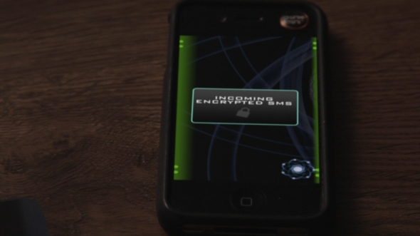 Dr. Pullman receives an encrypted text.