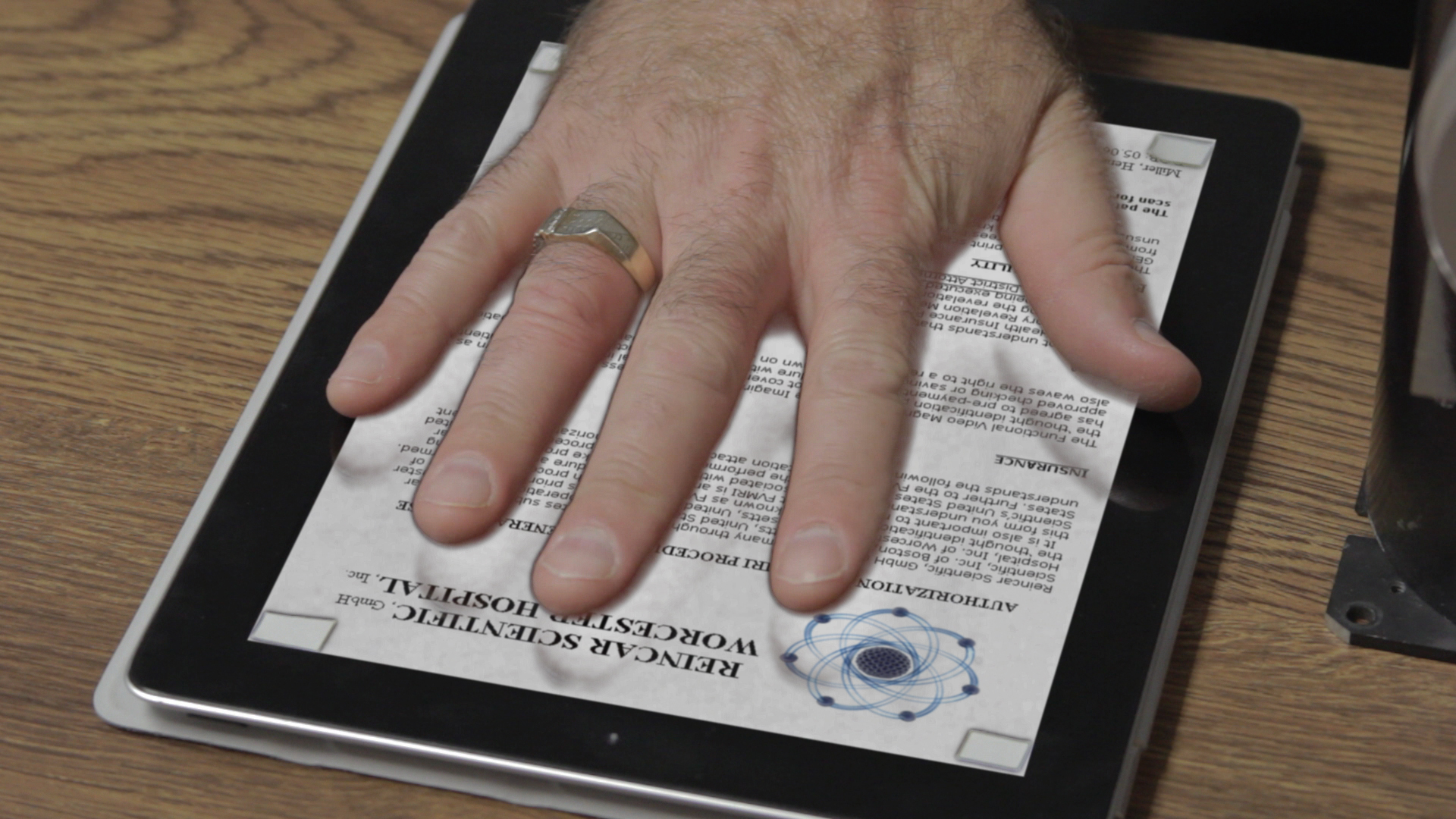"""Henri Miller """"signs"""" an authorization form with a hand print."""