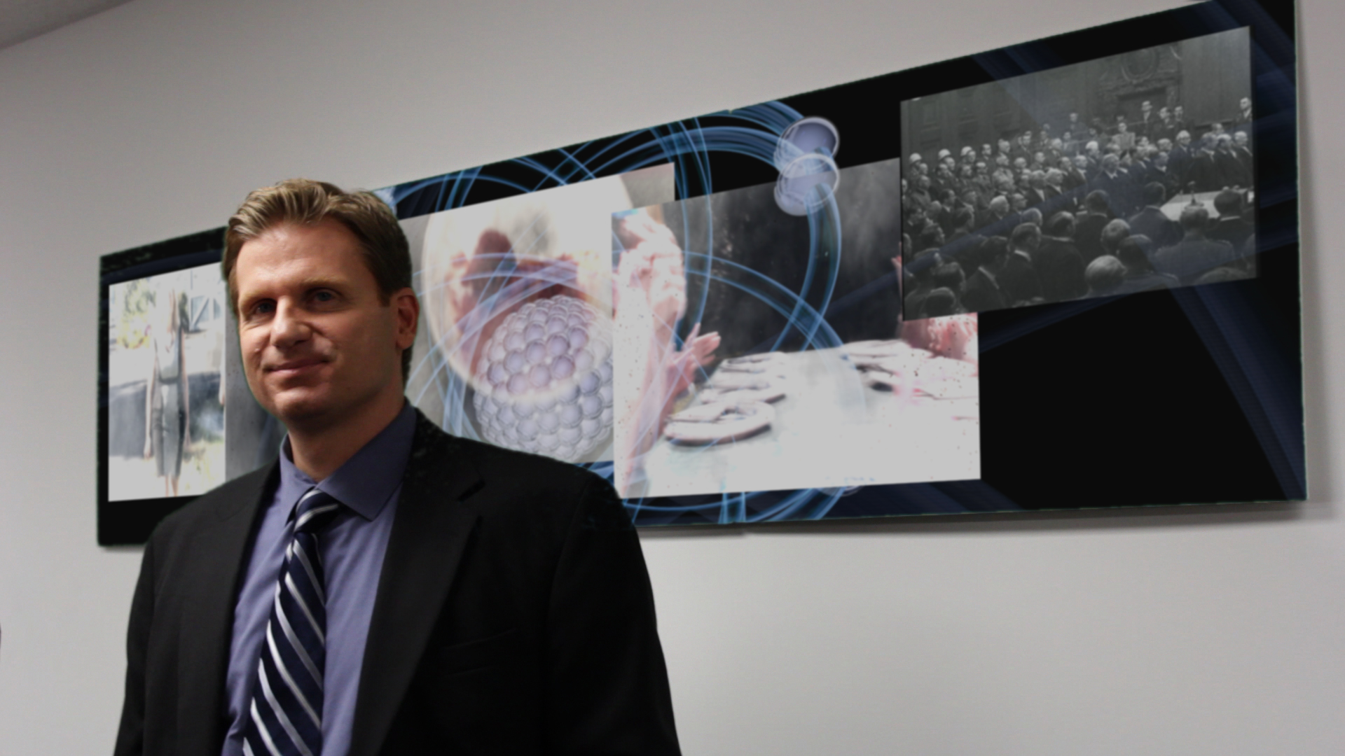 Reincar Scientific's chief legal counsel watches the trial on TV.