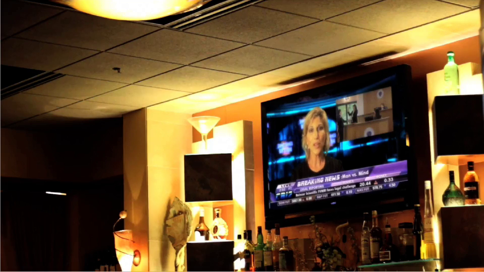 Running on mute, the trial plays on TV in Henri's restaurant.