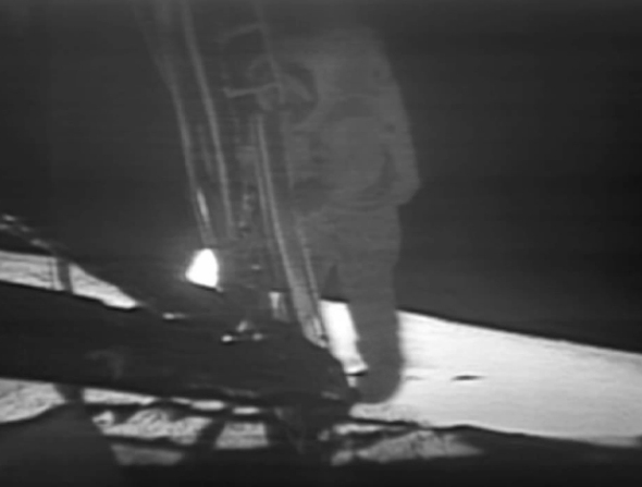 Neil Armstrong descends the ladder of the Apollo Lunar Module to become the first human to step foot on the surface of the Moon.