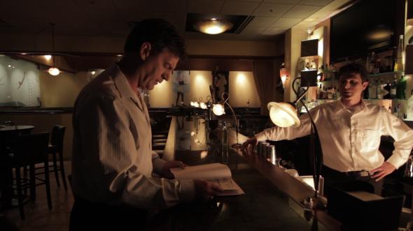 Henri Miller (Vernon Aldershoff) talks with his manager Brian Kovski (Jesse Mangan).