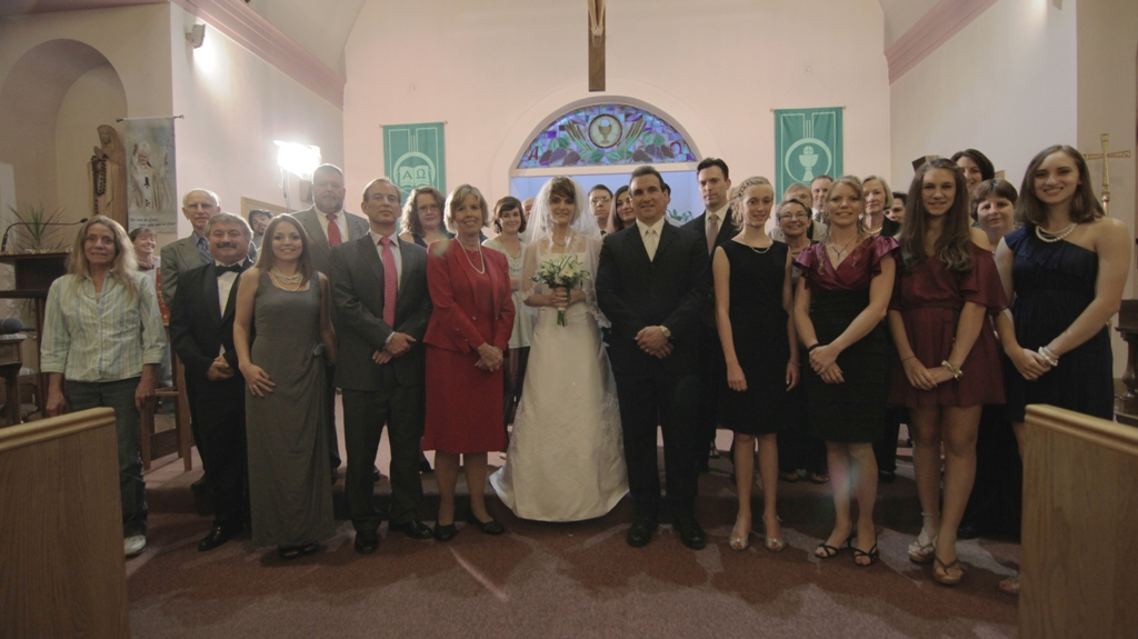 From the POV memory scene, the wedding guests.