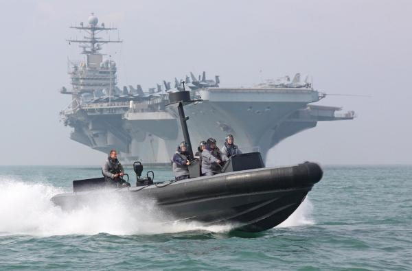 Just like in SOS United States an aircraft carrier from the United States arrives in the United Kingdom. Pictured -  USS Theodore Roosevelt will anchor off Stokes Bay, Gosport.