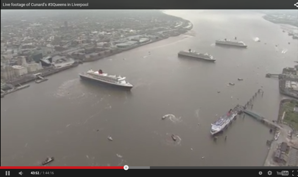 The Queen Mary 2 (left) can be seen in front of the Cunard Building, with Queen Victoria (c) and Queen Elizabeth (r).