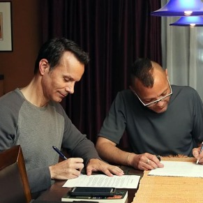 Signing the contract.