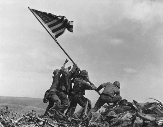 Raising the Flag on Iwo Jima on February 23, 1945 during the Battle of Iwo Jima in World War II.